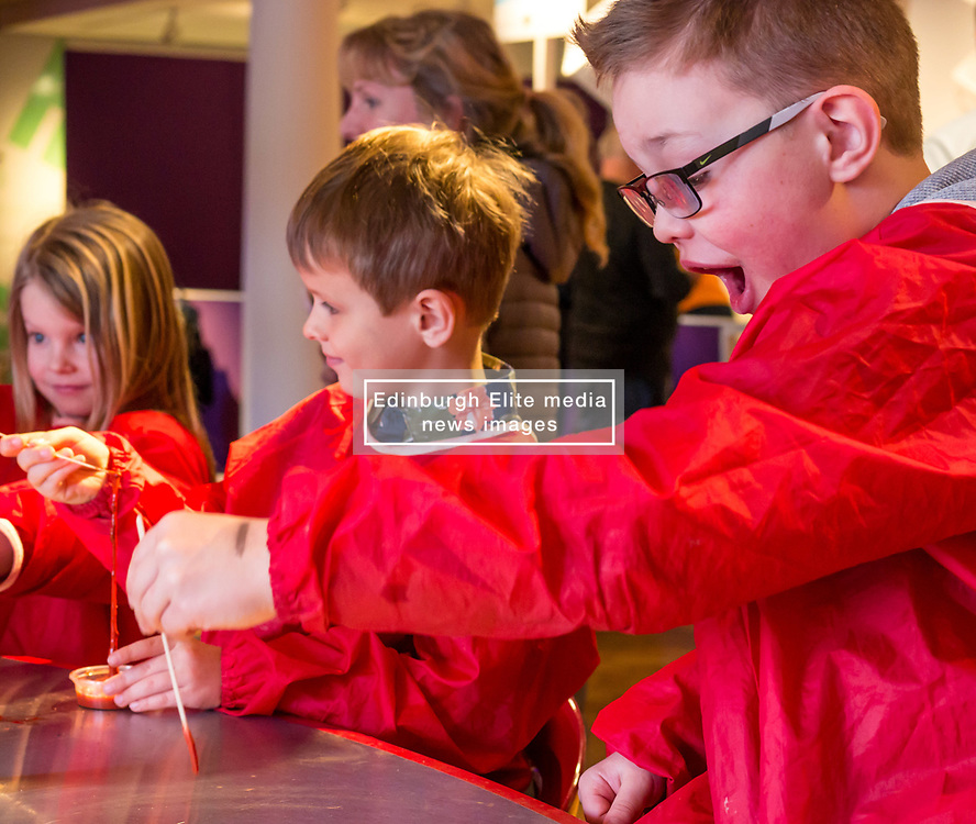 City Arts Centre, Edinburgh, Scotland, United Kingdom, 9 April 2019. Edinburgh Science Festival:  Jamie Carter, age 8 years, with twins Alex and Evie, age 6 years, have fun learning about blood at the Blood Bar drop in event at the Science Festival. <br /> <br /> Sally Anderson | EdinburghElitemedia.co.uk