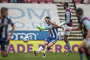 Craig Morgan (Wigan Athletic) clears the ball as Jonathan Kodjia (Aston Villa) tries to block it during the EFL Sky Bet Championship match between Wigan Athletic and Aston Villa at the DW Stadium, Wigan, England on 18 March 2017. Photo by Mark P Doherty.