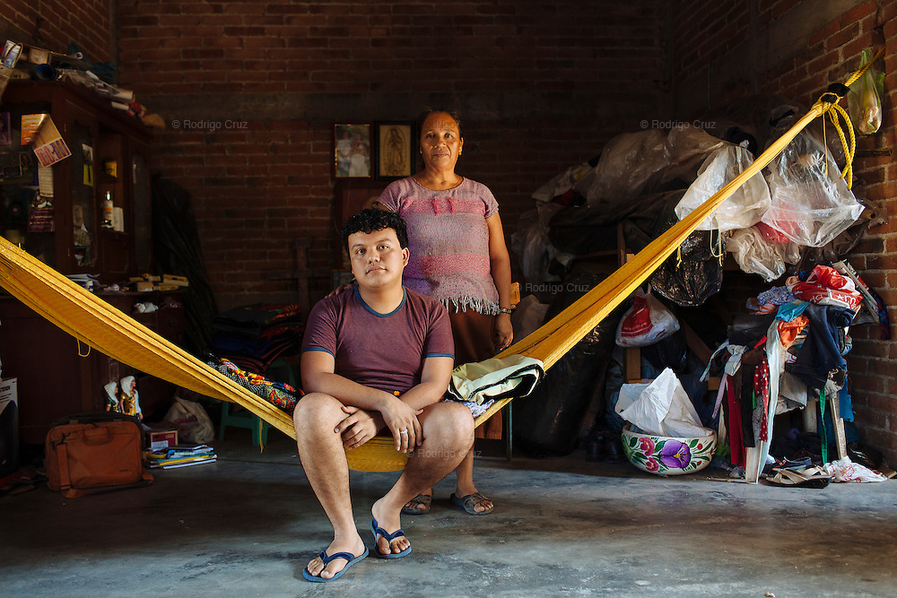 "Angelo Martinez Linares, 24, and her mother Ofelia Linares Sanchéz, 49, in Juchitán, Mexico.<br /> <br /> In Juchitán in the southern state of Oaxaca, Mexico, the world is not divided simply into gay and straight, the locals make room for a third category, whom they call ""muxes"".<br /> <br /> Muxes are men who consider themselves women and live in a socially sanctioned netherworld between the two genders. ""Muxe"" is a Zapotec word derived from the Spanish ""mujer"" or woman; it is reserved for males who, from boyhood, have felt themselves drawn to living as a woman, anticipating roles set out for them by the community.<br /> <br /> They are considered hard workers that will forever stay by their mothers side, taking care for their families operating as mothers without children of their own.<br /> <br /> Not all muxes express they identities the same way. Some dress as women and take hormones to change their bodies. Others favor male clothes. What they share is that the community accepts them."