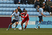 Swindon Town midfielder Anton Rodgers (26)  gets a hold of Coventry City midfielder Joe Cole (14) and gets a yellow card for his troubles during the Sky Bet League 1 match between Coventry City and Swindon Town at the Ricoh Arena, Coventry, England on 19 March 2016. Photo by Simon Davies.