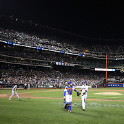 Pitcher Jacob deGrom and catcher Travis d'Arnaud, leave the field after the last out in the seventh inning during the New York Mets Vs Miami Marlins MLB regular season baseball game at Citi Field, Queens, New York. USA. 18th April 2015. Photo Tim Clayton