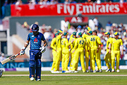 A dejected England ODI all rounder Moeen Ali walks off as the Australians celebrate his wicket during the 5th One Day International match between England and Australia at Old Trafford, Manchester, England on 24 June 2018. Picture by Simon Davies.