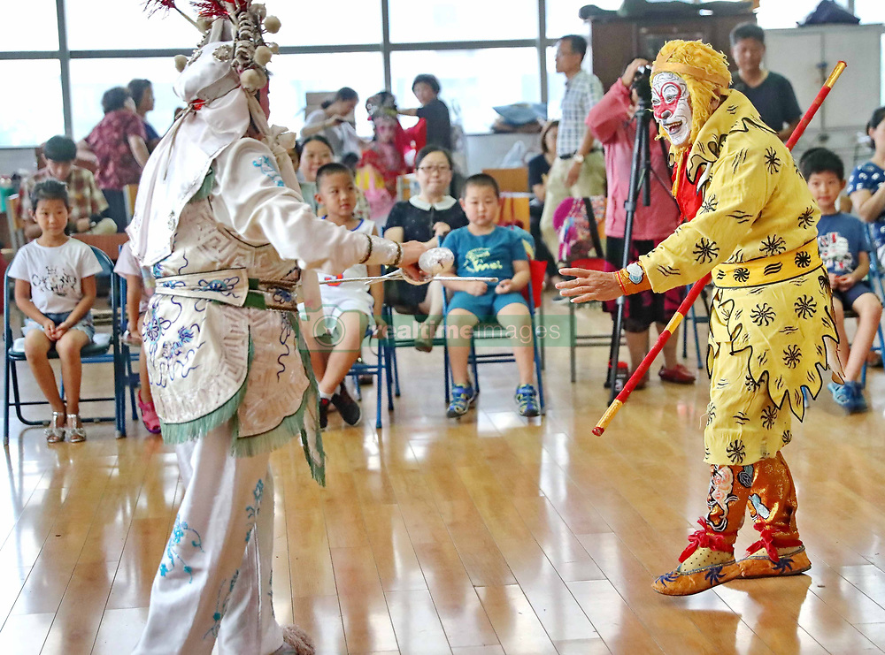 July 20, 2017 - Qinhuangdao, Qinhuangdao, China - Qinhuangdap, CHINA-July 20 2017: (EDITORIAL USE ONLY. CHINA OUT) ..Children enjoy traditional Chinese culture of Peking Opera in Qinhuangdao, north China's Hebei Province, July 20th, 2017. (Credit Image: © SIPA Asia via ZUMA Wire)