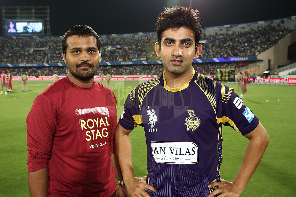 The Royal Stag Cricket Gear Fan of the Match with Kolkata Knight Riders captain Gautam Gambhir during the first semi final match of the Oppo Champions League Twenty20 between the Kolkata Knight Riders and the Hobart Hurricanes held at the Rajiv Gandhi Cricket Stadium, Hyderabad, India on the 2nd October 2014<br /> <br /> Photo by:  Shaun Roy / Sportzpics/ CLT20<br /> <br /> <br /> Image use is subject to the terms and conditions as laid out by the BCCI/ CLT20.  The terms and conditions can be downloaded here:<br /> <br /> http://sportzpics.photoshelter.com/gallery/CLT20-Image-Terms-and-Conditions-2014/G0000IfNJn535VPU/C0000QhhKadWcjYs