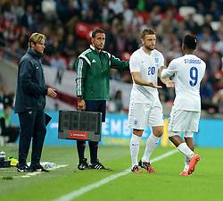 England's Daniel Sturridge (Liverpool)  comes off for England's Rickie Lambert (Liverpool) - Photo mandatory by-line: Alex James/JMP - Mobile: 07966 386802 - 3/09/14 - SPORT - FOOTBALL - London - Wembley Stadium - England v Norway - International Friendly
