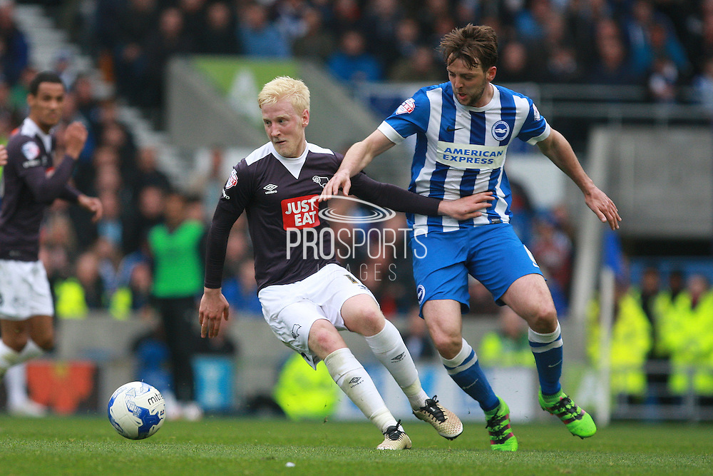 Derby County midfielder Will Hughes shields the ball from Brighton central midfielder Dale Stephens during the Sky Bet Championship match between Brighton and Hove Albion and Derby County at the American Express Community Stadium, Brighton and Hove, England on 2 May 2016. Photo by Bennett Dean.