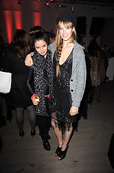 Left to right, BIP LING and EDIE CAMPBELL at the Polo Jeans Co. hosted Art Stars Auction in support of the Teenage Cancer Trust held at Phillips de Pury & Co, Howick Place, London on 6th December 2010.