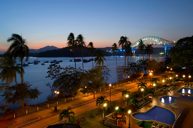 The Bridge Of The Americas is the Pacific entrance to the Panama Canal and the Amador Causeway is a pedestrian walkway that runs along Panama Bay and a local hotel's swimming pools.