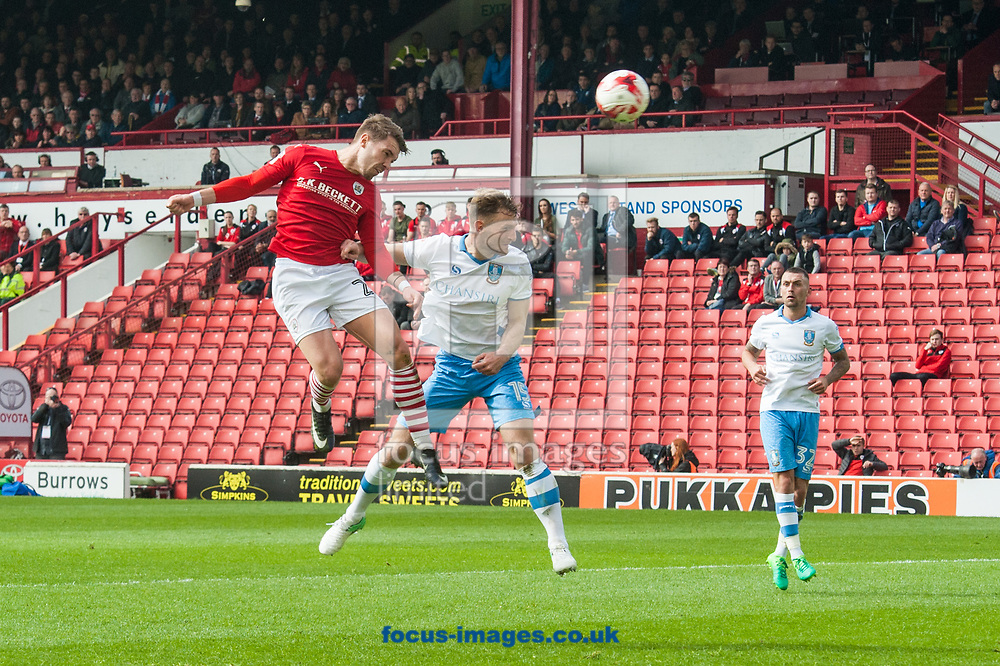 Tom Bradshaw of Barnsley outjumps Tom Lees of Sheffield Wednesday to get a header in on goal during the Sky Bet Championship match at Oakwell, Barnsley<br /> Picture by Matt Wilkinson/Focus Images Ltd 07814 960751<br /> 01/04/2017