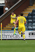 AFC Wimbledon defender & captain Barry Fuller (2) heads the ball during the EFL Sky Bet League 1 match between Rochdale and AFC Wimbledon at Spotland, Rochdale, England on 27 August 2016. Photo by Stuart Butcher.