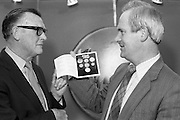 First 20p Coin..1986..29.10.1986..10.29.1986..29th October 1986..At the Central Bank's Currency Centre and Mint the Minister for Finance,Mr John Bruton,was on hand for the issue of the new 20p coin..Initially 20 million new 20p coins will be put into circulation...Picture shows The Minister for Finance,Mr John Bruton TD,accepting a presentation card of the coinage currently in circulation within the state.The presentation was carried out by Tomás F. Ó Cofaigh,Governor of The Central Bank.