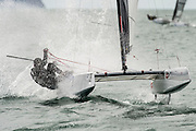 Emirates Team New Zealand sailor Glenn Ashby (AUS111) rescues a tricky manouver at the top mark in race five of the A Class World championships regatta being sailed at Takapuna in Auckland. 13/2/2014