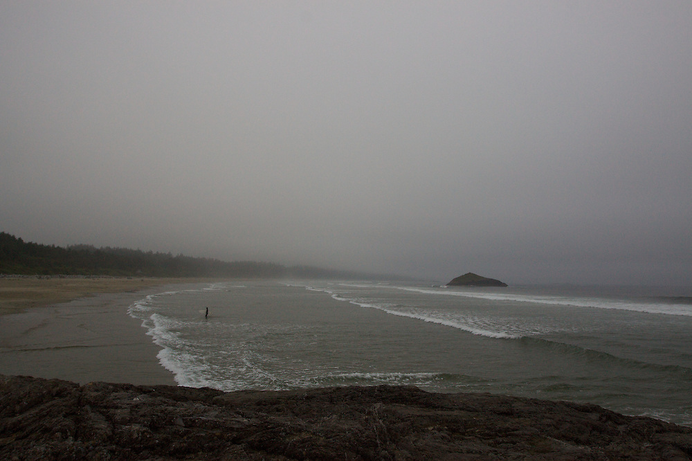 outdoor,Tofino,British Columbia,Canada,surf photo,cold water,ocean pacific,fog,cloudy day,surfer on the beach.