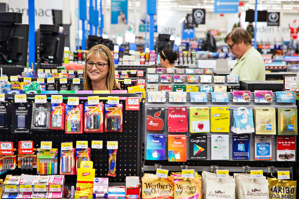 ROGERS, AR - OCTOBER 12:  Customer Erin Harriman checks out at Walmart Store #4208 on October 12, 2015 in Rogers, Arkansas.  <br /> CREDIT Wesley Hitt for Wall Street Journal<br /> WALSQUEEZE