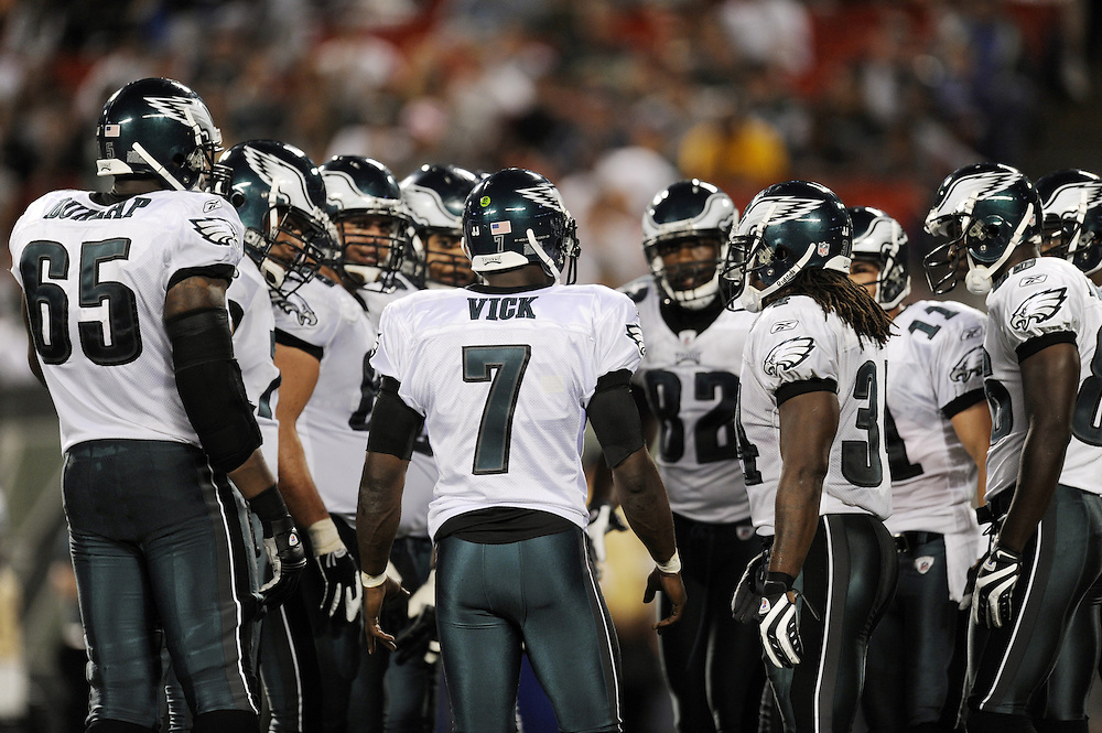 EAST RUTHERFORD, NJ - SEPTEMBER 3: Michael Vick #7 of the Philadelphia Eagles in the huddle during the game against the New York Jets on September 3, 2009 at Giants Stadium in East Rutherford, New Jersey. The Jets won 38-27. (Photo by Rob Tringali) *** Local Caption *** Michael Vick