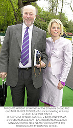 MR CHRIS WRIGHT chairman of the Chrysalis Group PLC and MRS JANICE STINNES, at a race meeting in Surrey on 26th April 2002.	OZK 13