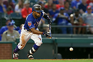 March 26, 2018 - Arlington, TX, U.S. - ARLINGTON, TX - MARCH 26: Texas Rangers center fielder Delino DeShields (3) lays down a bunt single during the exhibition game between the Cincinnati Reds and Texas Rangers on March 26, 2018 at Globe Life Park in Arlington, TX. (Photo by Andrew Dieb/Icon Sportswire) (Credit Image: © Andrew Dieb/Icon SMI via ZUMA Press)