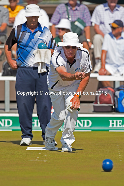 Elmwood`s Alvin Gardiner bowls watched by KaiKorai`s Mike Kernaghan in the men`s single final at the National Open Bowls Championship 2014, Browns Bay Auckland, New Zealand, Sunday, January 04, 2015. Photo: David Rowland/www.photosport.co.nz