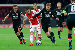 Hakim Ziyech #22 of Ajax and Fredrik Midtsjo #6 of AZ Alkmaar,  Jordy Clasie #20 of AZ Alkmaar in action during the Dutch Eredivisie match round 25 between Ajax Amsterdam and AZ Alkmaar at the Johan Cruijff Arena on March 01, 2020 in Amsterdam, Netherlands