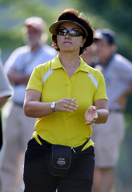 HAVRE DE GRACE, MD, June 7, 2007:  Bo Wie, mother of Michelle Wie, claps while watching her daughter play during the first round of the LPGA Championship in Havre De Grace, MD on June 7, 2007.  (Photo by Todd Bigelow/Aurora)