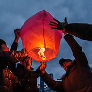 Young men launch a paper lantern during Deaboreum, the Korean festival celebrating the year's first full moon, at Haeundae Beach in Busan, South Korea.