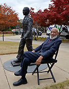 Oxford, MS 11/11/19   James Meredith, the first African American to attend Ole Miss, is on campus shooting a documentary. Meredith is seen standing and sitting by the statue of himself on the campus of the University of Mississippi right behind the Lyceum building. Meredith has never been a fan of the statute and even asked it be removed and destroyed when it was first installed.  Photo copyright ©SuziAltman