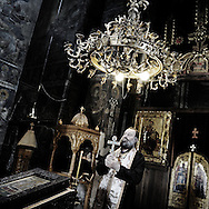 Orthodox priest in the monastery of Gracanica serb enclave protected by KFOR