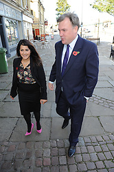 © Licensed to London News Pictures. 27/10/2014<br /> Ed Balls Arriving with Naushabah Khan.<br /> Ed Balls, Labour's shadow chancellor,has been in Rochester on the campaign trail  today(27.10.2014)<br /> Mr Balls was joined by Labour candidate Naushabah Khan at Bruno's French Bakes shop in Rochester high Street to meet local people and make Carrot cake with Bruno Breillet  (Pastry Chief) and Naushabah Khan .<br /> Hilary Benn MP, Labour's Shadow Communities and Local Government Secretary was also at the event.<br /> <br /> (Byline:Grant Falvey/LNP)