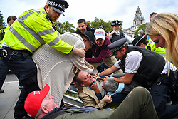 © Licensed to London News Pictures. 09/09/2019. London, UK. Scuffles break out between Leave and Remain protesters outside the Commons on the final day before Parliament is prorogued, suspending proceedings until October 31.  Photo credit: Guilhem Baker/LNP