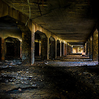 Derelict coal bunker in large building
