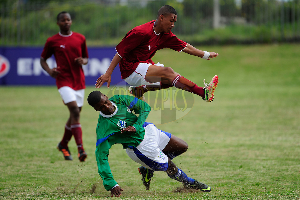 A VP Highs School player jumps over James Meyer of Gelnville FC during the final day of the 2012 Engen Knockout Challenge held at Port Elizabeth in the Eastern Cape, South Africa on the 23rd September 2012..Photo by Iky/SPORTZPICS