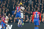 Crystal Palace #4 Luka Milivojevic and Manchester United Midfielder Paul Pogba in aerial battle during the Premier League match between Crystal Palace and Manchester United at Selhurst Park, London, England on 27 February 2019.