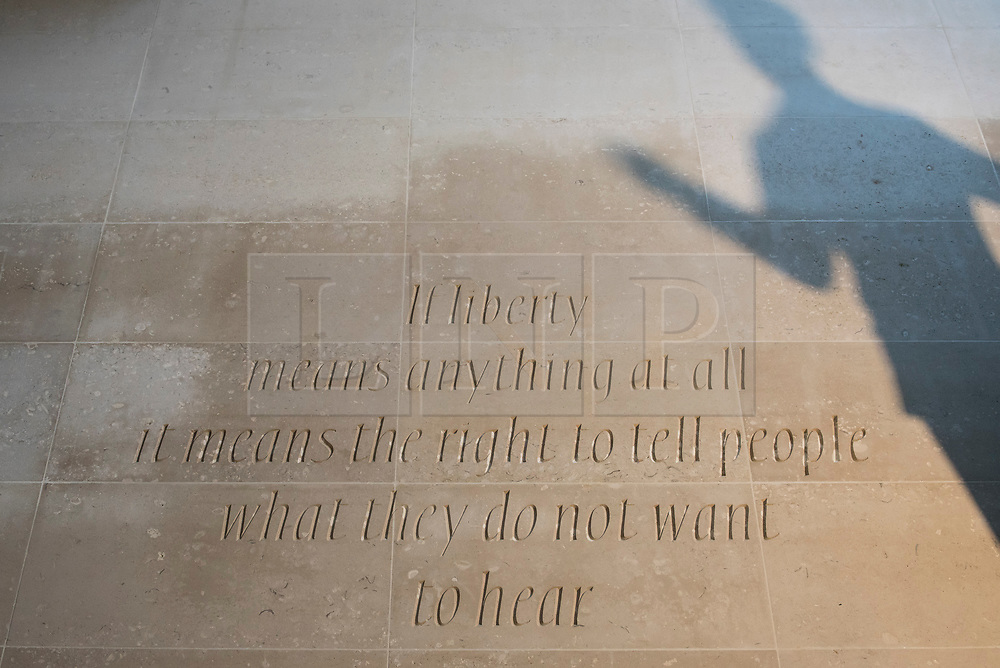 """© Licensed to London News Pictures. 07/11/2017. London, UK.  A statue of author George Orwell is unveiled outside the BBC headquarters in Portland Place.  Accompanying the statue is an inscription which reads """"If liberty means anything at all it means the right to tell people what they do not want to hear"""".  Photo credit: Stephen Chung/LNP"""