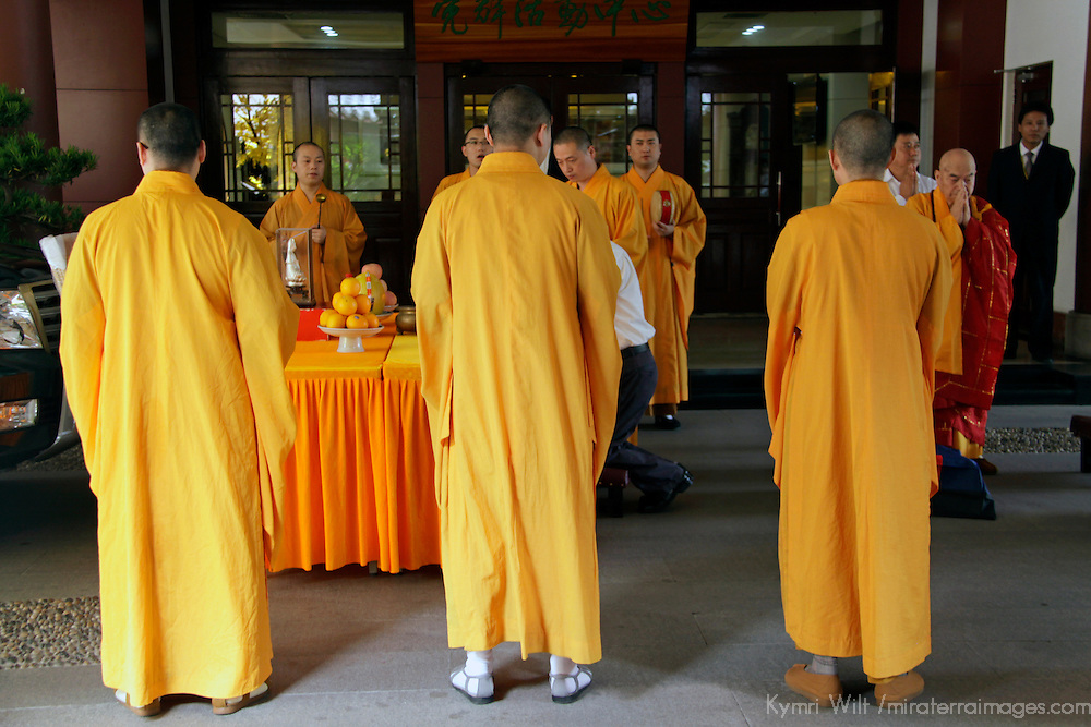 Asia, China, Shanghai. Monks actviely worship at the Jade Buddha Temple.