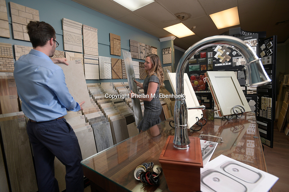 Adam Vellequette, left, and Ashley Vellequette pick out tile at the KBF Design Gallery showroom Monday, Sept. 18, 2017, in Altamonte Springs, Fla. (Photo by Phelan M. Ebenhack)