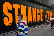 The word Strange is written in large orange lettering as part of Strange Days, an video arts exhibition, on 3rd October 2018, in London, England. 'Strange Days: Memories of the Future', is a new exhibition presented by New York's New Museum and The Store X in partnership with The Vinyl Factory, at London's The Store X, 180 The Strand. The Massimiliano Gioni-curated exhibition features work by some of the world's most exciting film-makers and video artists, presented as large-scale, multi-screen video installations, many of which are being shown in the UK for the first time.