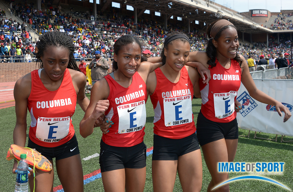 Apr 25, 2014; Philadelphia, PA, USA; Members of the Columbia (NJ) girls 4 x 800m relay take a victory lap after winning the Championship of America race in 8:45.37 in the 120th Penn Relays at Franklin Field. From left: Aigner Bobbitt and Olivia Baker and Emilie Cowan and Imani Coleman .