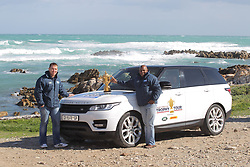 Handout photo provided by Fast Track PR of 1995 Rugby World Cup winner Chester Williams and 2007 Rugby World Cup winning captain John Smit take the Webb Ellis Cup during Land Rovers Least Driven Path to the most Southern Point in Africa, Cape Agulhus during the Rugby World Cup Trophy Tour in partnership with Land Rover and DHL. Photo issued Friday August 22, 2014 by the PRESS ASSOCIATION. Photo credit should read: Fast Track/Handout/PA Wire. NOTE TO EDITORS: This handout photo may only be used in for editorial reporting purposes for the contemporaneous illustration of events, things or the people in the image or facts mentioned in the caption. Reuse of the picture may require further permission from the copyright holder.