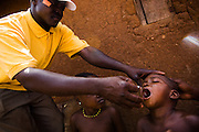 A health worker vaccinates a child during a national polio immunization exercise in the village of Wantugu, northern Ghana on Friday March 27, 2009.