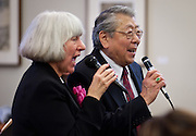 "Vocalists Jo Peterson (left) and Henry ""Shig"" Sakamoto perform with the Minidoka Swing Band in the US Bank Room of Multnomah County Library - Central branch, Portland, Oregon. The performance was in conjunction with Portland Center Stage's production of Snow Falling on Cedars, by David Guterson."
