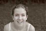 Smiling Girl shoulders up in Summer Field, seen shoulders up, tank top shoulder straps, hair pulled back