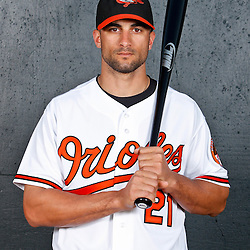 February 26, 2011; Sarasota, FL, USA; Baltimore Orioles right fielder Nick Markakis (21) poses during photo day at Ed Smith Stadium.  Mandatory Credit: Derick E. Hingle