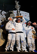 14FEB10 The 33rd America's Cup, Valencia, Spain..BMW Oracle Racing win the America's Cup 2010. .left to right, Skipper / Helmsman James Spithill; CEO of BMW Oracle Racing Russell Coutts; CEO of Oracle Larry Ellison; and Tactician John Kostecki. Coutts lifts the America's Cup in their win over Alinghi, to take the Cup back to the San Fransisco's Golden Gate Yacht Club.