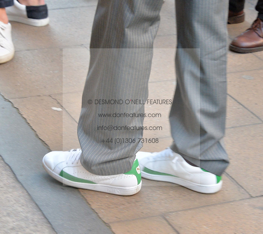 BORIS BECKER's shoes at a private view of woks by German artist Mike Dargas held at the Opera Gallery, 134 New Bond Street, London on 5th July 2016.