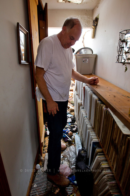 May 25, 2011- Pastor Leon Stump of Joplin, Missouri looks through his record collection after a Tornado came through the town on Sunday, May 22, 2011. Stump says that he had over 5,000 records which consisted of mainly gospel and country music. Credit: David Welker / TurfImages.com
