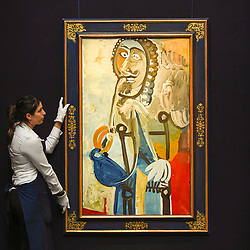 "© Licensed to London News Pictures. 14/06/2019. LONDON, UK.  A technician presents ""Homme à la pipe"", 1968, by Pablo Picasso (Est. £5.5-7.5m). Preview of Impressionist and Modern art sales, which will take place at Sotheby's New Bond Street on 18 and 19 June 2019. Photo credit: Stephen Chung/LNP"