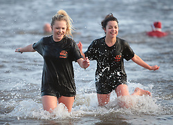 Licensed to London News Pictures. 01/01/2013, Whitley Bay, North Tyneside, UK. Hundreds of swimmers brave the freezing North Sea as they take to the water in the annual Panama Swimming Club New Year Swim at Whitley Bay. Photo credit: Adrian Don/LNP