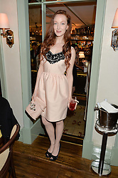 Actress OLIVIA GRANT at a dinner hosted by Kate Spade NY to celebrate Chelsea in Bloom held at Daphne's, 112 Draycott Avenue, London on 20th May 2015.