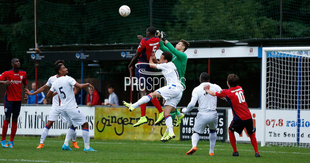 Moussa Diarra beating Chris Kettings to the high ball during the Pre-Season Friendly match between Hampton & Richmond and Crystal Palace at Beveree Stadium, Richmond Upon Thames, United Kingdom on 27 July 2015. Photo by Michael Hulf.