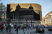 UNITED KINGDOM, London: 17 January 2017 Shadows cast from the surrounding buildings of the famous advertising boards of Piccadilly Circus seem to replicate a circus tent. The lights have been turned off to be replaced with a new Ultra HD curved screens in Autumn 2017 and is the first time since the Blitz that the billboards have been turned off for a prolonged period of time. Rick Findler / Story Picture Agency